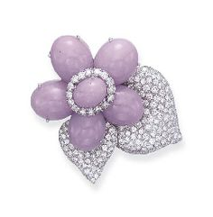 A DIAMOND AND JADE BROOCH, BY SABBADINI  Designed as a cabochon lavender jade flower, enhanced by circular-cut diamonds, extending pavé-set diamond leaves, mounted in 18k white gold Signed Sabbadini, made in Italy.