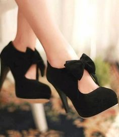 Gorgeous black velvet pumps with a bow detail at the front