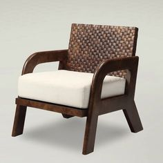 A stunning minimalist armchair made of a polished and woven coconut shell by Dsign - an awesome detail for any interior.