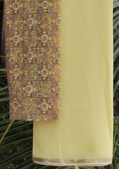 A simple plain yellow Saree in georgette paired with a gorgeous embroidered…