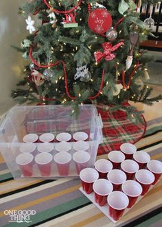 ornaments organizer Use a clear tote and party cups to safely store ornaments