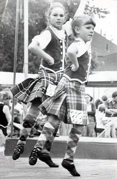 Jennifer McCormack (left) from London and Anne Milne from Owen Sound, keep in step to the sound of the pipes in the eight-year-old open Highland Fling contest at the Dutton Highland Games 1978.