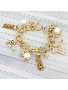 Goldtone Tassel and Cross Toggle Bracelet
