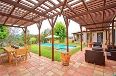 Mediterranean Patio with Trellis & exterior terracotta tile floors ...