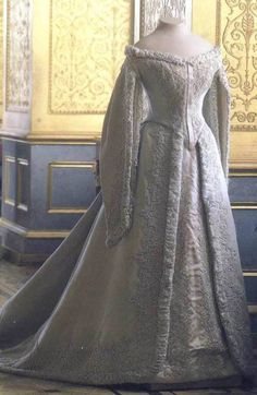 This is a court dress worn by Alexandra on another day.  Her wedding dress probably looked much like this one.  The actual dress was lost during the Revolution