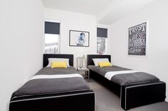 A stylish upholstered twin bed that is perfect for a shared room.