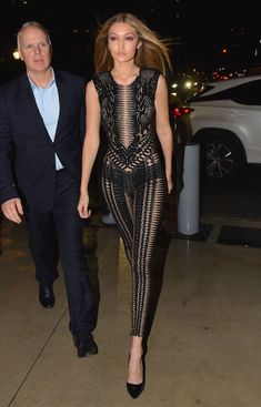 Model Gigi Hadid sports a revealing black Julien Macdonald bodysuit during NYFW for the launch of this year's Sports Illustrated swimsuit issue on February Celebrity Red Carpet, Celebrity Style, Urban Fashion, Love Fashion, Kendall, Kylie, Gigi Hadid Style, Leggings Fashion, Celebs
