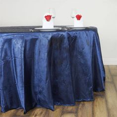 """Adoringly Adorned Satin Lily Round Tablecloth 120"""" - Navy Blue / The seamless luster of satin, ultimate delicacy of adorable Lilies, and timeless elegance of embossing all fused together to create the most adoring masterpiece ever! Our adoringly adorned satin lily tablecloth is an exquisite stroke of genius that combines the softness of satin with the charm of lilies and artistry of embossing. Create an ethereal ambiance at your next special event by spreading this silky floriated tablecloth…"""
