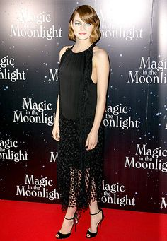 Emma Stone steps out in a Chloe dress at the Magic in the Moonlight premiere in Paris