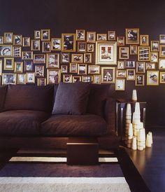 Black walls, gold frames.