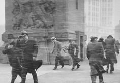 """Braving the elements while crossing the Michigan Ave Bridge, 1935, Chicago ** THEY DON'T CALL IT THE """"WINDY CITY"""" FOR NO REASON !!! ***"""