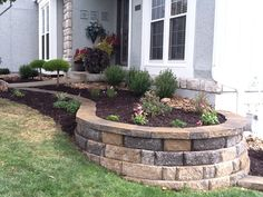 landscaping with curved retaining wall