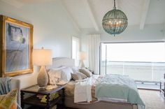 Dress up your beachy bedroom with an unexpected chandelier.