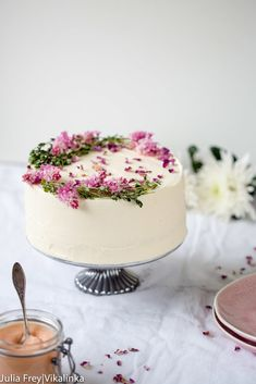 Rose Rhubarb Layer Cake. Delicate vanilla bean flavoured sponge layered with rhubarb curd and frosted with rose water and vanilla mascarpone. This cake is what dreams are made of!