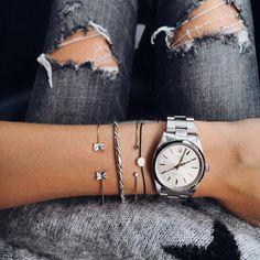 silver rolex + dainty bracelets
