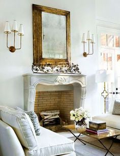 Love Fireplace with gold mirror & sconces& floor lamp. so so pretty.