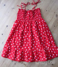 So sweet, so simple. Girls Cotton Dress with shirring and ruffles from Wag Doll. Nice tutorial with lots of photos.