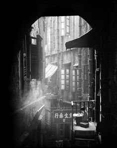 +~+~ Vintage Photograph ~+~+     Another incredible image taken by Fan Ho on the streets of Hong Kong.  Click to view the picture larger - the layers, the light, the little girl, it evokes so much emotion....