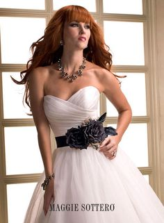 Maggie Bridal by Maggie Sottero April -FB111943    Style Number:April -FB111943  Feather Belt only    This is for the belt that is pictured only, the gown is sold separately.