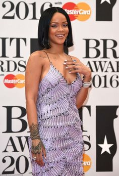 ANTI-Rihanna: She went against her usual edgy, hardened and funky style as she smiled thro...