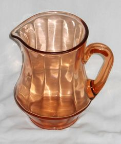 Pink Depression glass pitcher with wide ribs