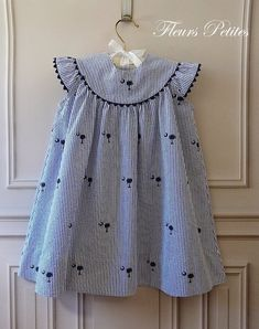 Girl& Round Yoke Dress featuring Embroidered Palmetto with Crescent Moon on. Girl& Round Yoke Dress featuring Embroidered Palmetto with Crescent Moon on Seersucker Girls Frock Design, Baby Dress Design, Baby Frocks Designs, Kids Frocks Design, Frocks For Girls, Little Girl Dresses, Vintage Baby Dresses, Baby Girl Dress Patterns, Skirt Patterns