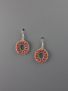 Open center sterling silver cluster earrings set with twelve red coral cabochons.