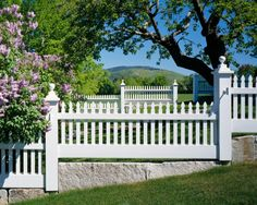 A stepped, Federal-style picket fence on granite plinths graces the picturesque property. Sloped Front Yard, Sloped Backyard, Front Yard Fence, Fence Gate, Fences, Driveway Gate, Front Yards, Front Entry, Backyard Ideas