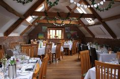 subtle use of acoustic clouds at Clavelshay Barn, Somerset Farm Shop, English Countryside, Wedding Venues, Barn Weddings, Wedding Ideas, Acoustic, This Is Us, Table Settings, Relax
