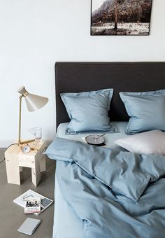 Babyblue bedding and small interior details are enough to make a bedroom welcoming and ready for relaxation. Less is more.