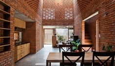 An ancient building material is used to create a surprisingly contemporary look for Termitary House, a personal residence in Da Nang, Vietnam.