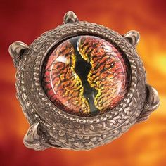 If you find a cave, you would no doubt find a deadly land dragon. This beautiful medieval home decor trinket box is made of cold-cast resin, which is then metalized with a deep antique bronze finish. A large red glass dragon eye adorns the top, while the inside has both a dragon's face and scales sculpted within. #medieval #antique #homedecor