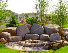 We adore this breathtaking natural stone that complements this gorgeous landscape.