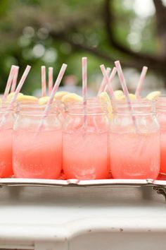 Looking for the right beverage to serve at your brunch? Fill Mason jars with pink lemonade and adorn them with lemon wedges and striped paper straws.