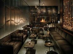Phillipe Starck: Love the brown couches, the dark brown wood, and the copper accents