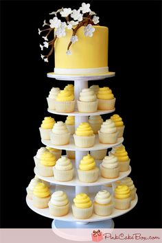 Yellow Cupcake Tower @Teresa Maloney what about something like this if i can pull it off for your wedding reception?