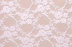 white stretch lace. (pictures were taken over a nude background)  Additional product details below    Purchase:    Price: $8.00 /yd