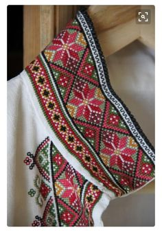 "bunadskjorte - Norwegian ""bunad"" shirt with fine cross stitch detail. A traditional pattern you see in sweaters, mittens, paintings etc. Folk Embroidery, Embroidery Fashion, Cross Stitch Embroidery, Embroidery Patterns, Cross Stitch Borders, Cross Stitch Designs, Cross Stitching, Cross Stitch Patterns, Scandinavian Embroidery"