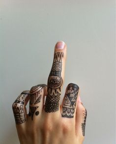 intricate finger tattoos