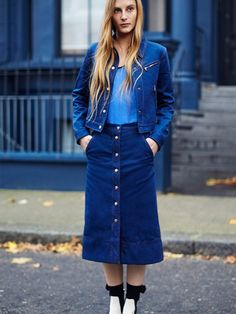 Rag & Bone button through midi-skirt worn with a denim jacket with zipper detail