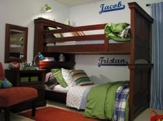 BOYS BUNKROOM , I totally quit trying to get the designer look on a budget for this room. I learned that it is designer look for a reason: you cant get the same look for cheap! So I used the color palette from the pillows for inspiration and went with my own design - on a budget..., Simple wall decals personalized their spaces.        , Boys Rooms Design