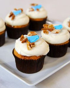 Hummingbird Cupcakes Recipe -- cupcakes baked with banana, pineapple, and pecan are topped with classic vanilla cream cheese frosting.