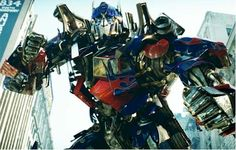 Optimus Prime!   He's just soooo epicaly awesome, not to mention his voice is so noble and resonating.  Google Image Result for http://therealmcast.com/wp-content/uploads/2012/03/optimus-prime-transformers-movie.jpg