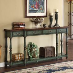 Features:  -Simple turned legs support the open display shelf.  -Four drawers.  -Can support a flat screen TV.  Top Finish: -Brown.  Top Material: -Manufactured wood.  Base Material: -Manufactured woo