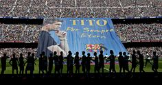 Barcelona and Getafe FC's players greet each other in front of a huge banner in tribute to former FC Barcelona's head coach Francesc 'Tito' Vilanova before their match at the Camp Nou Alberto Estevez/EPA