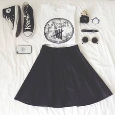 This outfit is really cute for 5 Seconds of Summer band fans. I can imagine someone wearing this to a concert or to go shopping. I love how the shirt is a muscle tee. It's cool to let boys know girls can have muscles too and boys aren't the only ones that are strong. #Girl Power!!!! Then you have some classic Chucks with retro glasses and cute accessories. Then we have the classic black skater skirt. This whole outfit reminds me of grungy rock band.    #Complimentary #Rock #Teen