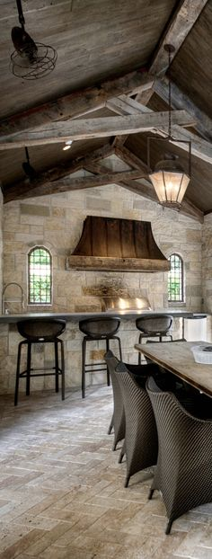 Wonderful covered outdoor kitchen.  Love the hood and stone/wood details.