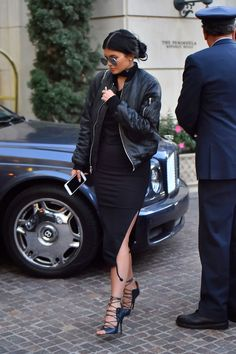 How to style a bomber jacket like Kylie Jenner: Throw it on a bodycon dress. DONE