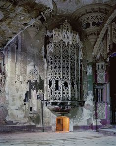 For perspective, that's a doorway at the bottom of the iron cage. Part of the crumbling United Artists Theater in Detroit, Michigan. Photo by Andrew Moore.