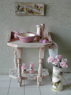 Cute shabby chic table with accessories.